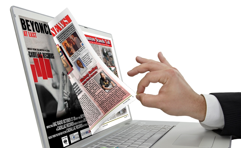Photo of a magazine morphed into a laptop